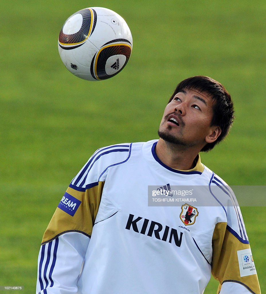 Japan's midfielder Daisuke Matsui looks at the ball prior to their training session in George, on June 16, 2010. Japan beat Cameroon in their first match and faces the Netherlands in Durban on June 19.