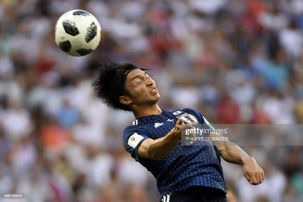 TOPSHOT - Japan's midfielder Gaku Shibasaki heads the ball during the Russia 2018 World Cup Group H football match between Japan and Poland at the Volgograd Arena in Volgograd on June 28, 2018. (Photo by Philippe DESMAZES / AFP) / RESTRICTED