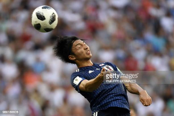 TOPSHOT Japan's midfielder Gaku Shibasaki heads the ball during the Russia 2018 World Cup Group H football match between Japan and Poland at the...