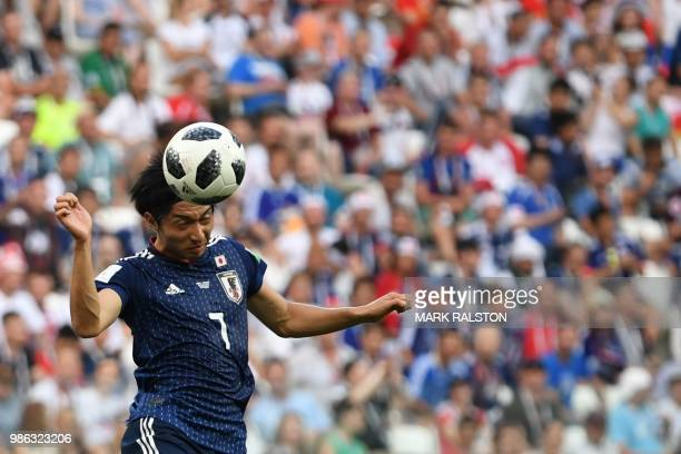 Japan's midfielder Gaku Shibasaki heads the ball during the Russia 2018 World Cup Group H football match between Japan and Poland at the Volgograd...