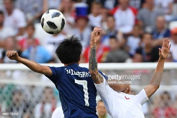TOPSHOT Japan's midfielder Gaku Shibasaki vies with Poland's midfielder Jacek Goralski during the Russia 2018 World Cup Group H football match...