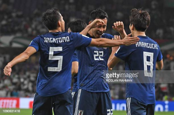 Japan's midfielder Genki Haraguchi celebrates his goal with teammates during the 2019 AFC Asian Cup semi-final football match between Iran and Japan...