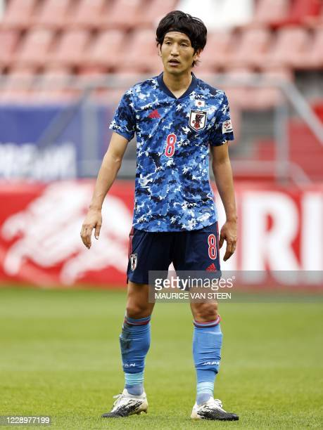 Japan's midfielder Genki Haraguchi looks on during a friendly football match between Japan and Cameroon at Stadion Galgenwaard in Utrecht on October...