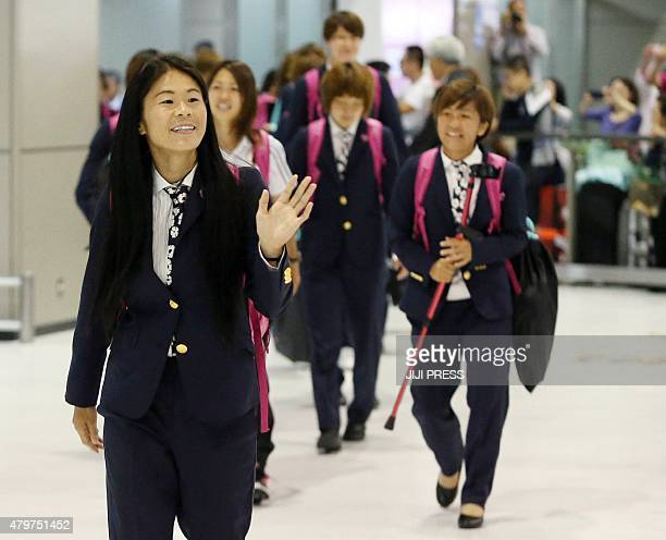 Japan's midfielder Homare Sawa and her teammates arrive at the Narita international airport in Narita suburban Tokyo on July 7 2015 as they returned...