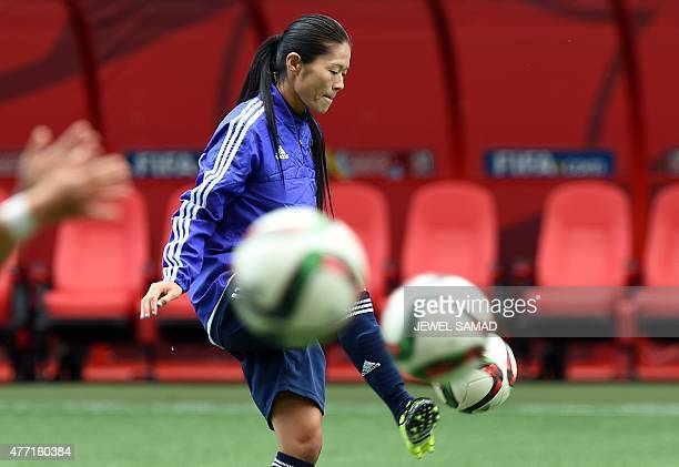Japan's midfielder Homare Sawa kicks a ball during a training session at the Winnipeg Stadium before their Group C football match of the 2015 FIFA...