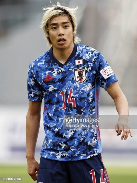 Japan's midfielder Junya Ito looks on during a friendly football match between Japan and Cameroon at Stadion Galgenwaard in Utrecht on October 9,...