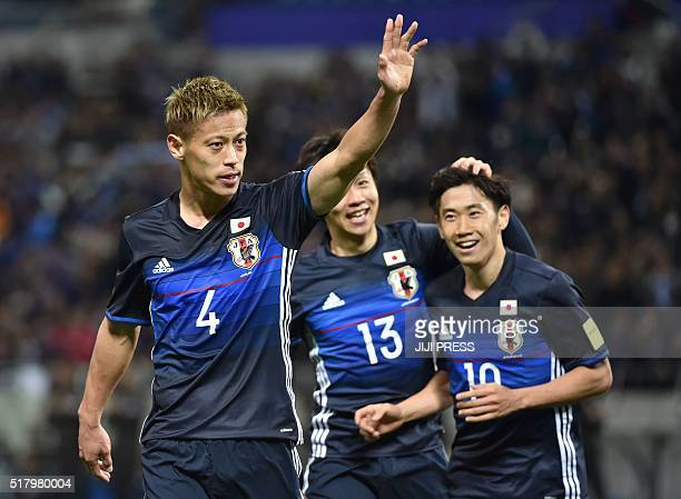 Japan's midfielder Keisuke Honda acknowledges to cheering fans following his goal against Syria during their football match of the 2018 World Cup...