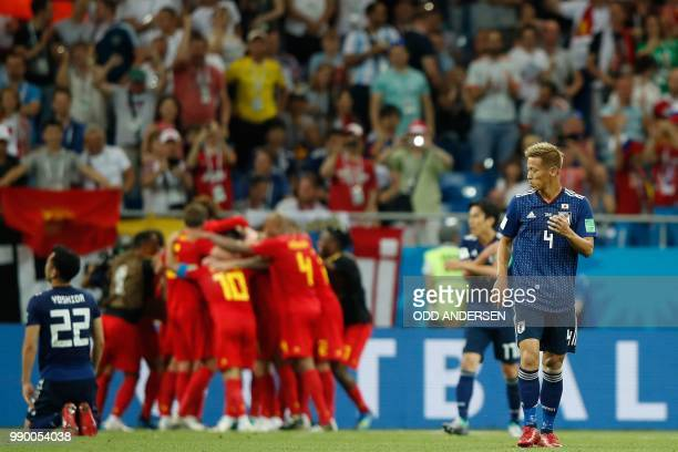 Japan's midfielder Keisuke Honda looks dejected after Belgium scored during the Russia 2018 World Cup round of 16 football match between Belgium and...
