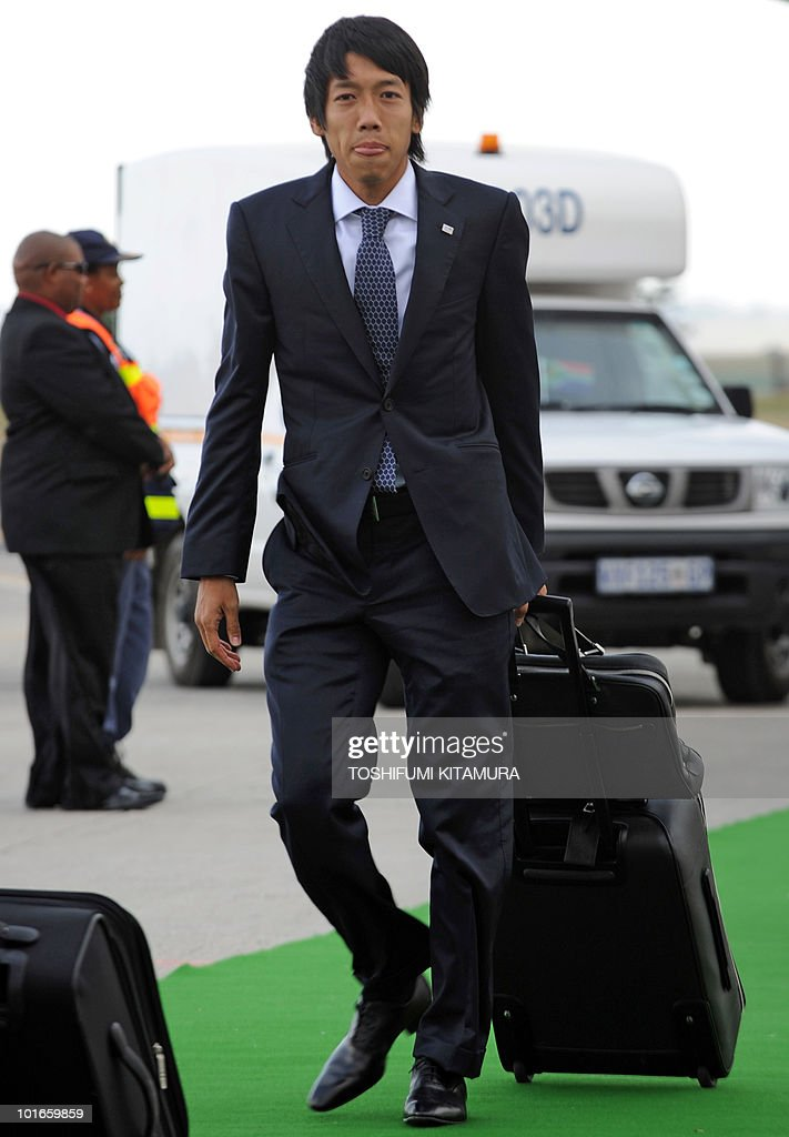 Japan's midfielder Kengo Nakamura walks toward the terminal upon the team's arrival at George airport on June 6, 2010. Japan's national football team arrived here to hold their 2010 World Cup training camp ahead of the start of the tournament on June 11.