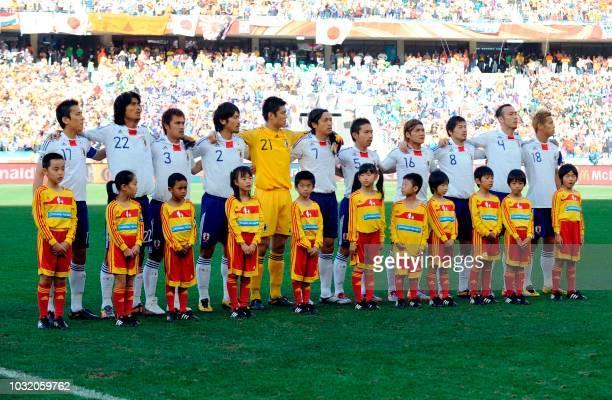 Japan's midfielder Makoto Hasebe Japan's defender Yuji Nakazawa Japan's defender Yuichi Komano Japan's midfielder Yuki Abe Japan's goalkeeper Eiji...