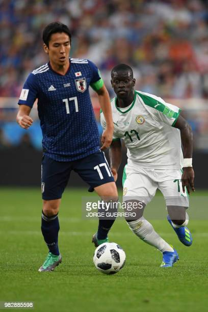 Japan's midfielder Makoto Hasebe vies with Senegal's midfielder Papa Alioune Ndiaye during the Russia 2018 World Cup Group H football match between...