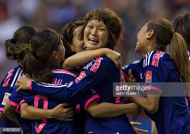 Japan's midfielder Mizuho Sakaguchi celebrates her goal against Netherlands with teammates during the round of 16 football match between Japan and...