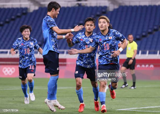 Japan's midfielder Ritsu Doan celebrates after scoring the second goal from the penalty spot during the Tokyo 2020 Olympic Games men's group A first...