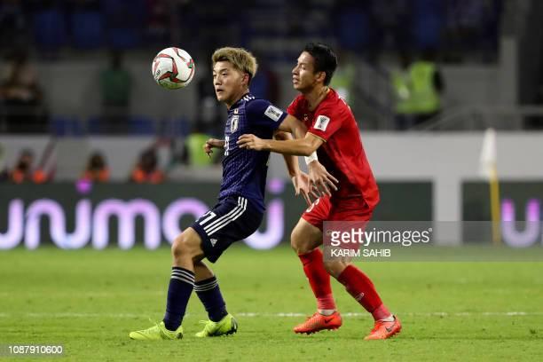 Japan's midfielder Ritsu Doan is marked by Vietnam's midfielder Xuan Truong Luong during the 2019 AFC Asian Cup quarterfinal football match between...