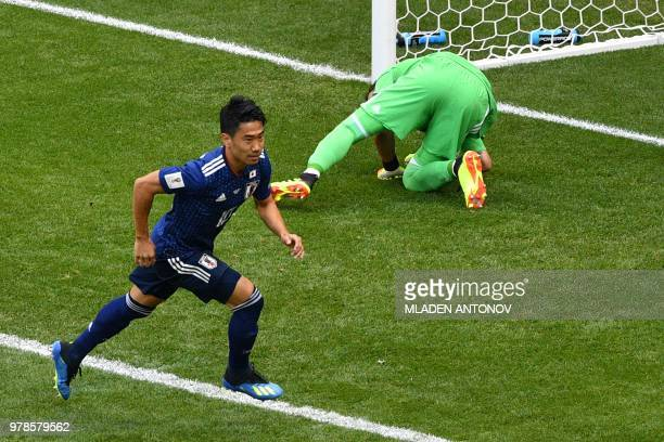Japan's midfielder Shinji Kagawa celebrates after scoring their first goal on a penalty during the Russia 2018 World Cup Group H football match...
