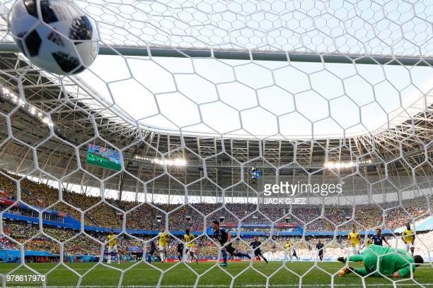 TOPSHOT Japan's midfielder Shinji Kagawa scores a penalty during the Russia 2018 World Cup Group H football match between Colombia and Japan at the...