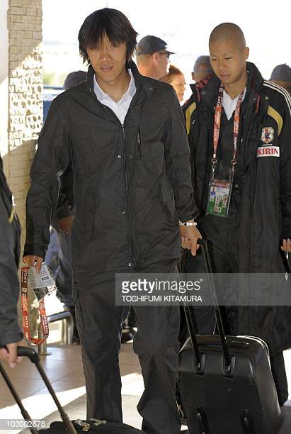 Japan's midfielder Shunsuke Nakamura and forward Takayuki Morimoto arrive at the terminal of George airport in the South African city of George on...