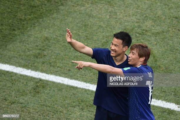 TOPSHOT Japan's midfielder Takashi Inui and Japan's forward Shinji Okazaki react after the final whistle of the Russia 2018 World Cup Group H...