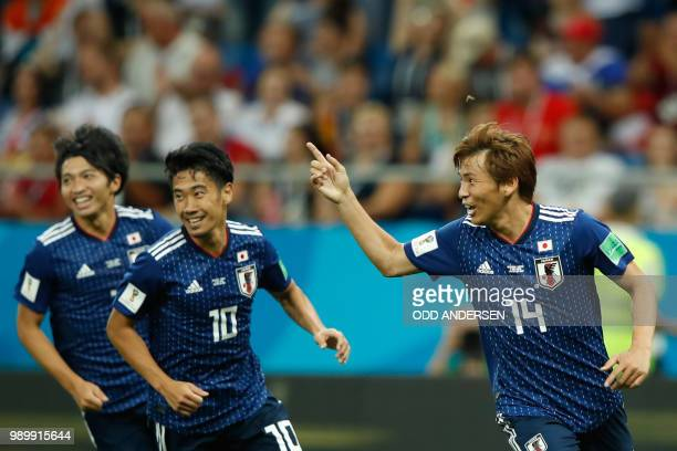 Japan's midfielder Takashi Inui celebrates after scoring during the Russia 2018 World Cup round of 16 football match between Belgium and Japan at the...