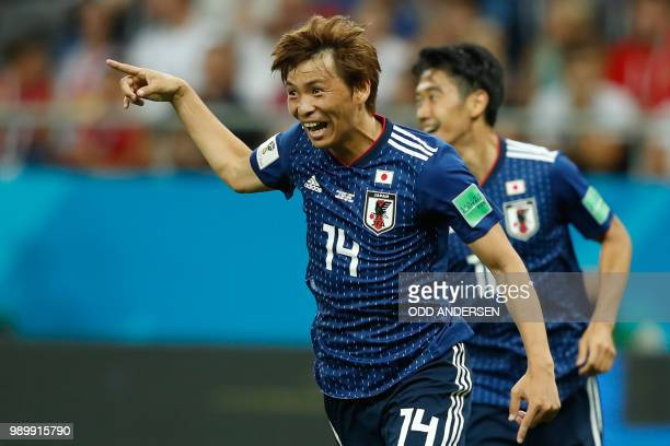 TOPSHOT Japan's midfielder Takashi Inui celebrates after scoring during the Russia 2018 World Cup round of 16 football match between Belgium and...