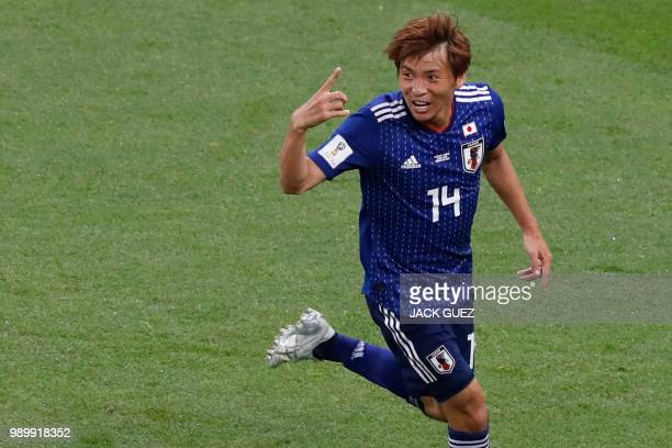 TOPSHOT Japan's midfielder Takashi Inui celebrates after scoring his team's second goal during the Russia 2018 World Cup round of 16 football match...