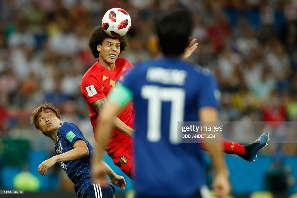 TOPSHOT - Japan's midfielder Takashi Inui (L) fights for the ball with Belgium's midfielder Axel Witsel during the Russia 2018 World Cup round of 16 football match between Belgium and Japan at the Rostov Arena in Rostov-On-Don on July 2, 2018. (Photo by Odd ANDERSEN / AFP) / RESTRICTED