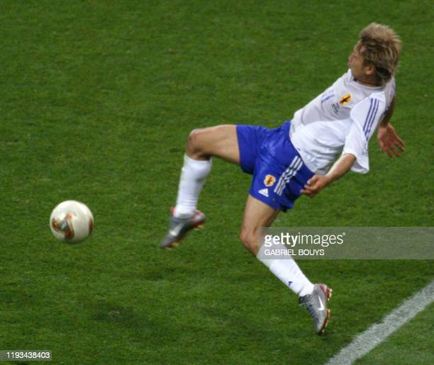 Japan's midfielder Takayuki Suzuki kicks the ball to score his team's second goal against Belgium during match 13 group H of the 2002 FIFA World Cup...