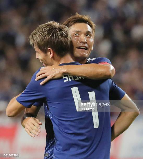 Japan's midfielder Toshihiro Aoyama and defender Sho Sasaki celebrate Japan's first goal during their friendly football match between Japan and Costa...