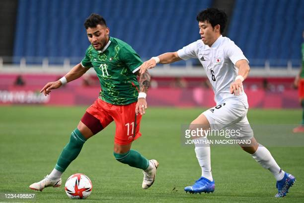 Japan's midfielder Wataru Endo vies for the ball with Mexico's forward Alexis Vega during the Tokyo 2020 Olympic Games men's bronze medal football...