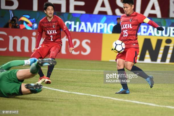 Japan's midfielder Yasushi Endo scores a goal against China's Shanghai Shenhua during the AFC Champions League group stage football match in Kashima,...