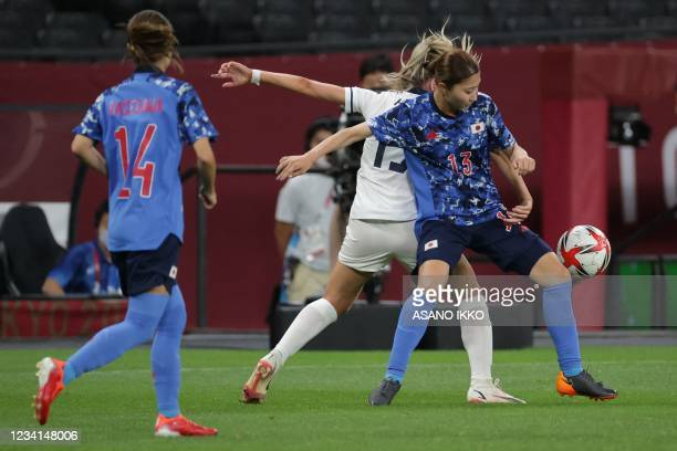 Japan's midfielder Yuzuho Shiokoshi controls the ball during the Tokyo 2020 Olympic Games women's group E first round football match between Japan...