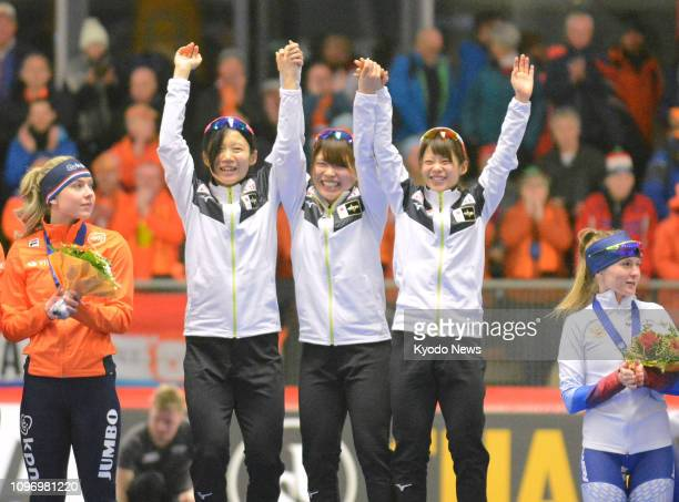 Japan's Miho Takagi Ayano Sato and Nana Takagi celebrate after winning the women's team pursuit event at the world single distance speed skating...