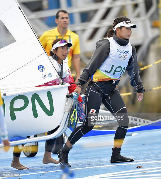 Japan's Miho Yoshioka and Ai Yoshida carry their boat after a race in the women's 470 sailing opening series at the Rio de Janeiro Olympics on Aug 16...