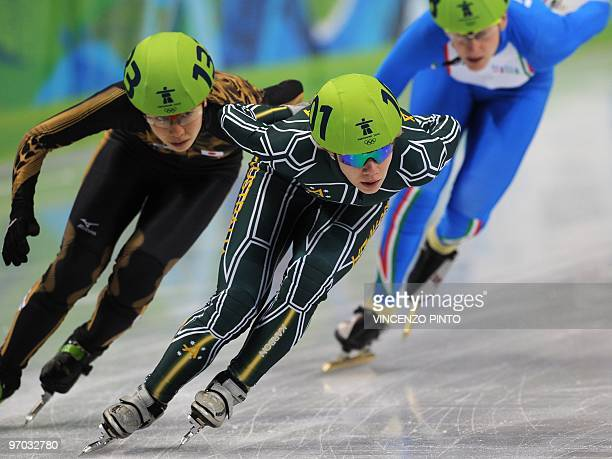 Japan's Mika Ozawa Australia's Tatiana Borodulina and Italy's Cecilia Maffei compete in the Women's Short Track Speedskating 1000m heats at the...