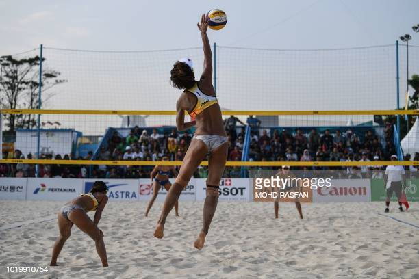 Japan's Miki Ishii serves against China in the women's beach volleyball during the 2018 Asian Games in Palembang on August 20 2018