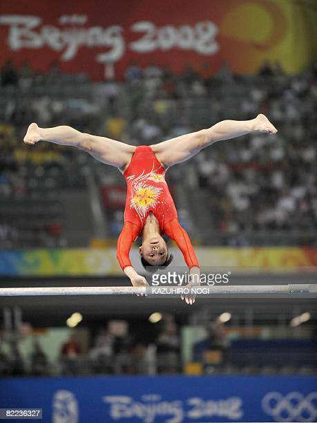 Japan's Miki Uemura competes on the uneven bars during the women's qualification of the artistic gymnastics event of the Beijing 2008 Olympic Games...