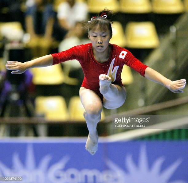 Japan's Miki Uemura in action during the women's team final beam exercises in Busan for the 14th Asian Games 02 October 2002 AFP PHOTO/YOSHIKAZU TSUNO