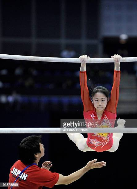 Japan's Miki Uemura performs in the uneven bars event during the Artistic Gymnastics World Championships 2009 at the 02 Arena in east London on...