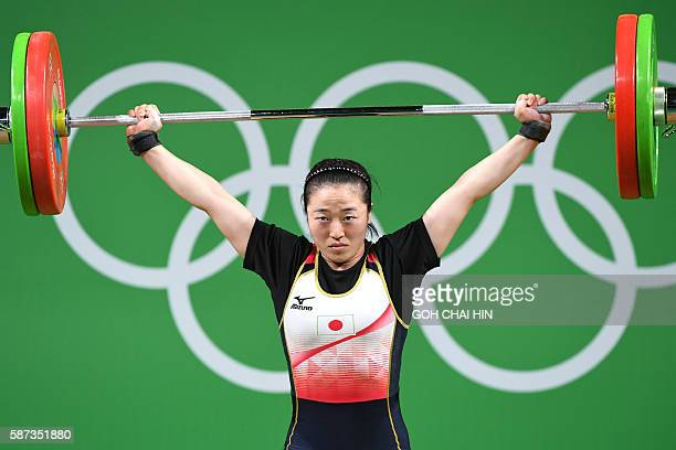 Japan's Mikiko Andoh competes in the Women's 58kg weightlifting competition at the Rio 2016 Olympic Games in Rio de Janeiro on August 8 2016 / AFP /...