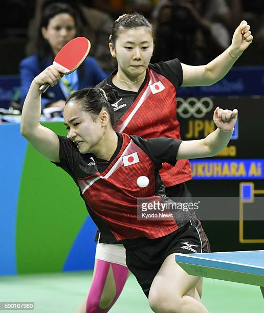 Japan's Mima Ito and Ai Fukuhara play during the bronze medal match in the women's table tennis team competition against Singapore at the Rio de...