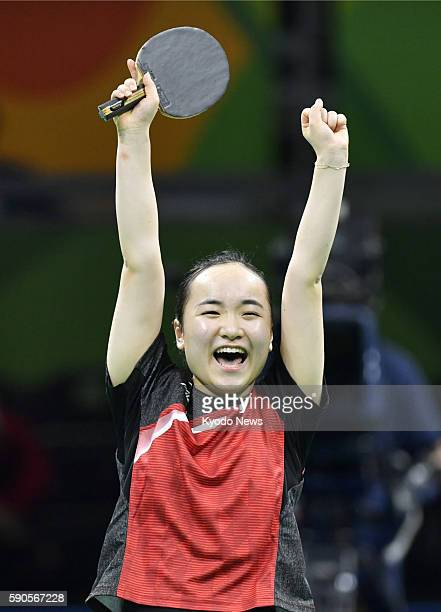 Japan's Mima Ito celebrates her win during the women's table tennis team bronze medal match against Singapore at the Rio de Janeiro Olympics on Aug...