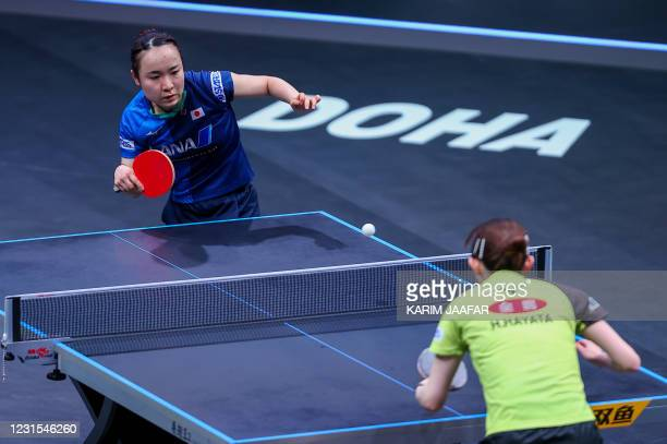 Japan's Mima Ito competes with Japan's Hina Hayata during the finals of the women's singles of the World Table Tennis Middle East Hub in the Qatari...