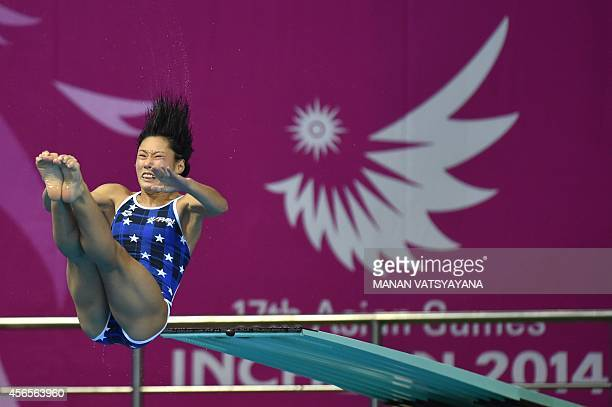 Japan's Minami Itahashi competes in the final of the women's 3m springboard diving event during the 17th Asian Games at the Munhak Aquatics Center in...