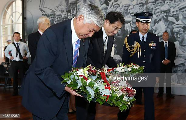 Japan's Minister of Defense Gen Nakatani and Minister for Foreign Affairs Fumio Kishida pay their respects and lay wreaths at a World War 2 Japanese...