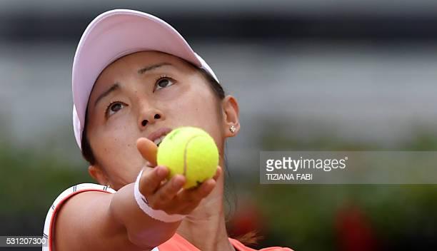 Japan's Misaki Doi serves against Romania's Irina-Camelia Begu during the WTA Tennis Open tournament at the Foro Italico on May 13, 2016 in Rome. /...