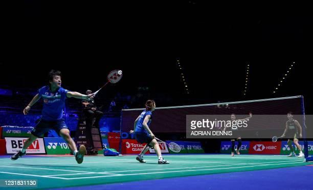 Japan's Misaki Matsutomo covers the net as Japan's Yuki Kaneko hits a backhand return to Malaysia's Chan Peng Soon and Malaysia's Goh Liu Ying during...
