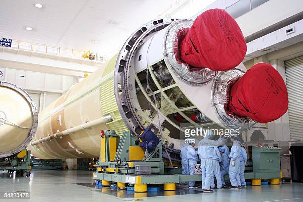 Japan's Mitsubishi Heavy Industries unveils the new H2B rocket at their factory at Tobishima village in Aichi prefecture near Nagoya on February 12...