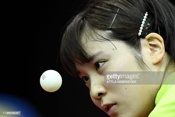 Japan's Miu Hirano eyes the ball as she serves the ball to Ukraine's Margaryta Pesotska on April 23, 2019 during their women's single match at the...