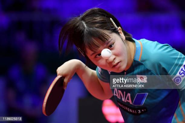TOPSHOT Japan's Miu Hirano serves to Canada's Mo Zhang on April 24 2019 during their women's single match at the ITTF World Table Tennis...