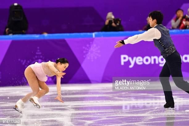 Japan's Miu Suzaki and Japan's Ryuichi Kihara compete in the figure skating team event pair skating free skating during the Pyeongchang 2018 Winter...
